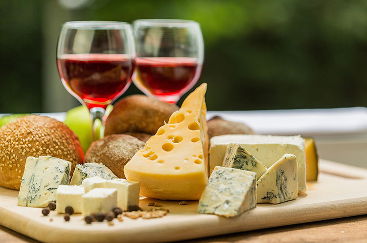 Plate of cheese and two glasses of wine